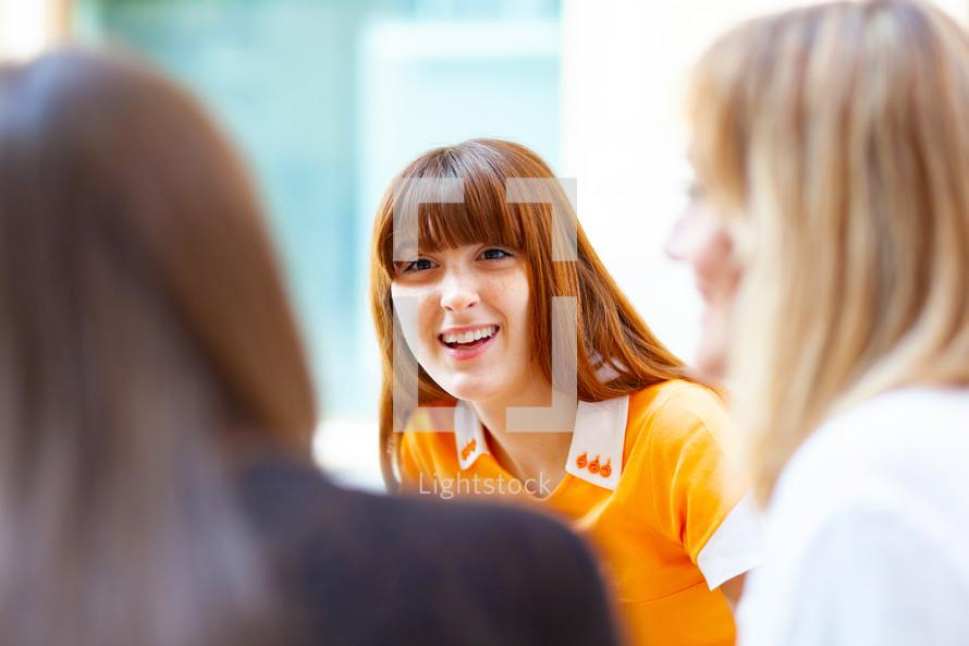 young women having a conversation