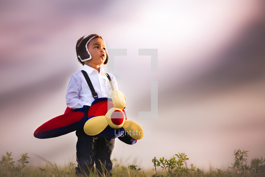 a toddler in an airplane costume