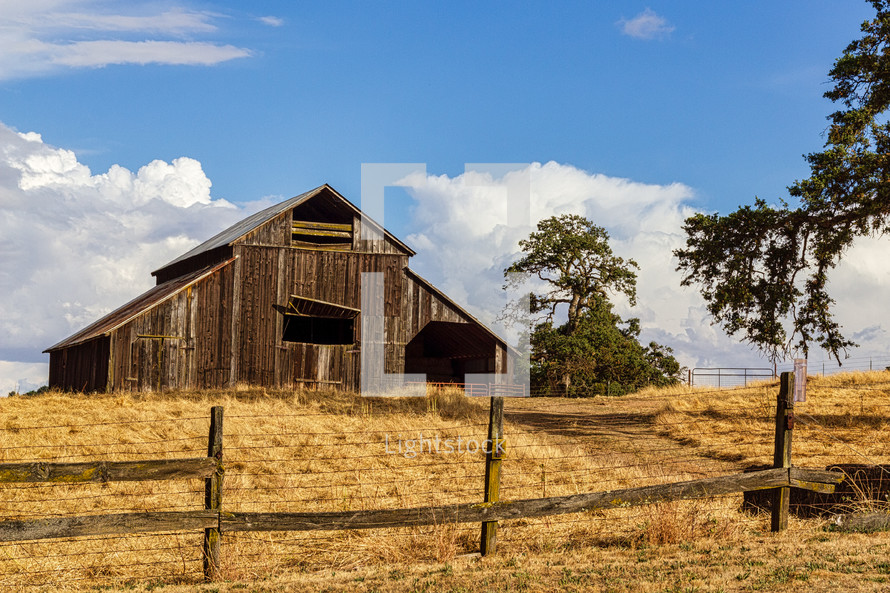 Barn with Fence in Foreground