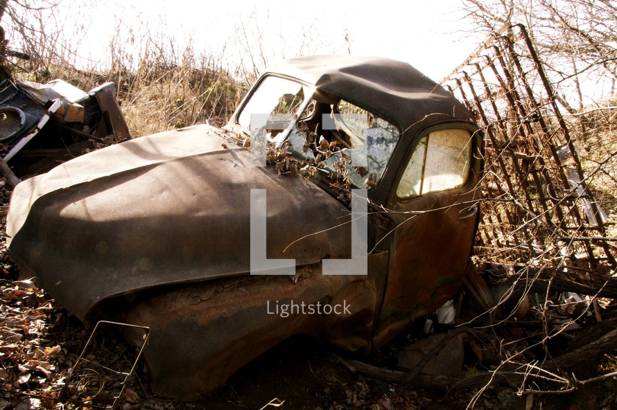 old rusted car in a junk yard