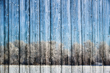 winter scene of a wood fence