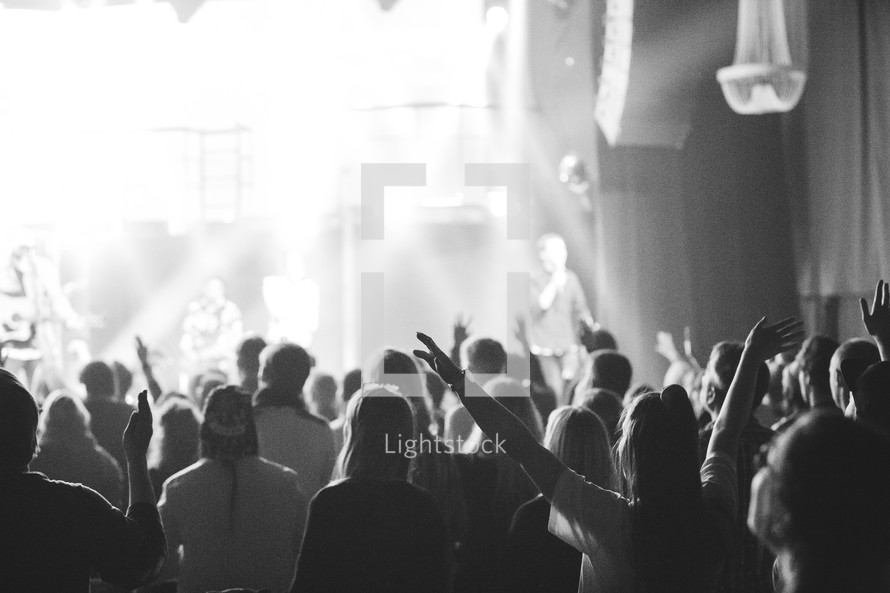 People worshipping Jesus with hands high during worship.
