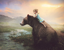 a little riding on a bear
