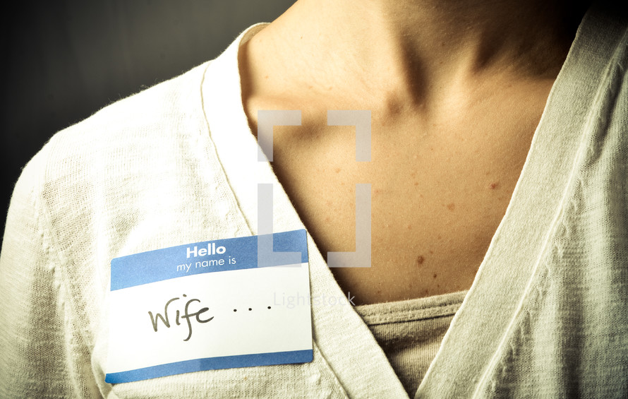 woman wearing a name tag with the word wife