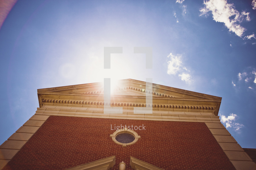 A church building and sunburst