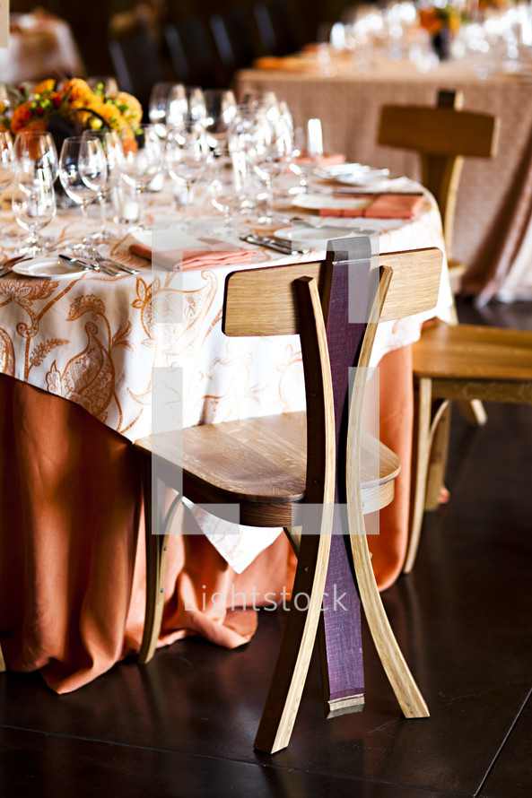 Tables set with formalwear and wine glasses oak wood chair made of wine barrels dining.