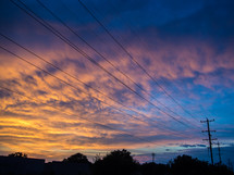 power lines under a sunset