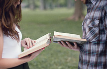 man and a woman reading the Bible to each other