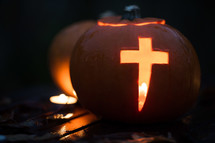pumpkin carved with cross - candle light