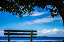 empty park bench with ocean view
