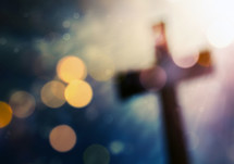bokeh lights and a shadow of a cross
