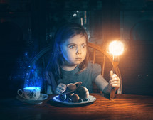 A little girl holds up the sun on her fork