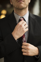 businessman adjusting his tie