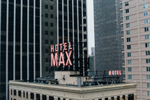 Hotel Max sign on the roof of a skyscraper