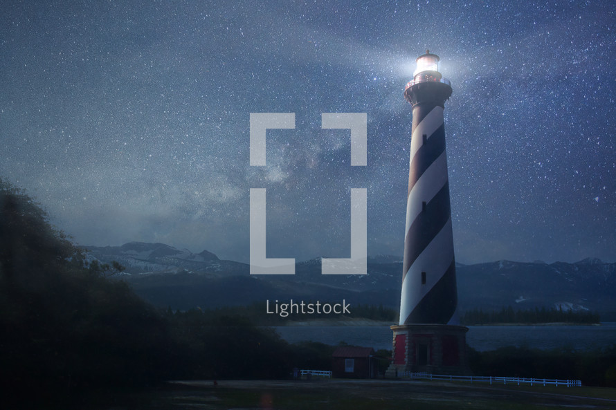 glowing lighthouse at night
