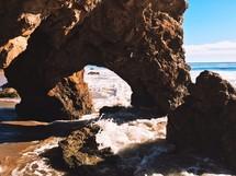 water rushing through rocks on a beach