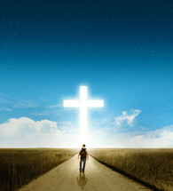man on a spiritual journey walking down a dirt road towards a cross glowing in the sky