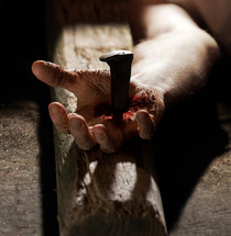 Jesus' hand nailed to the cross.