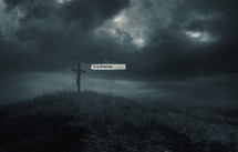 Jesus is hanging on the cross as darkness covers the earth