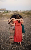women's group standing together in prayer
