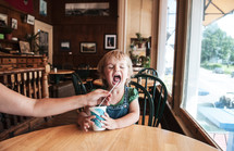 toddler drinking from a straw
