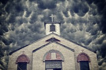 boarded up church under a cloudy sky