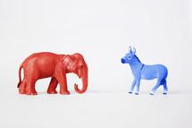 A red Republican elephant and a blue Democratic donkey.