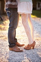 legs of a couple hugging