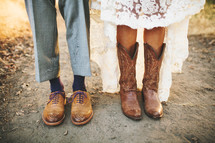 shoes and cowboy boots of a man and woman