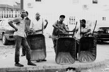men with wheel barrows on a street