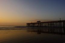 beach pier at dusk