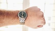 wrist watch on a man's wrist