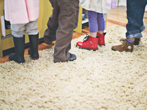 children wearing rain boots