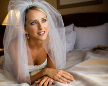 Happy bride lying on bed