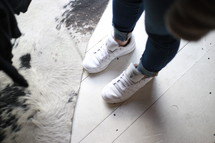 feet in white sneakers