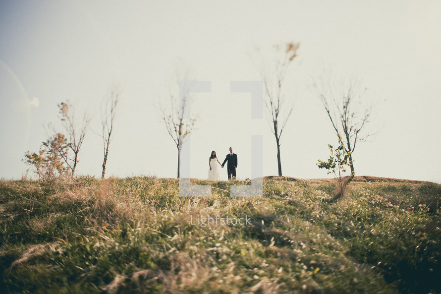 Bride and groom on a hill