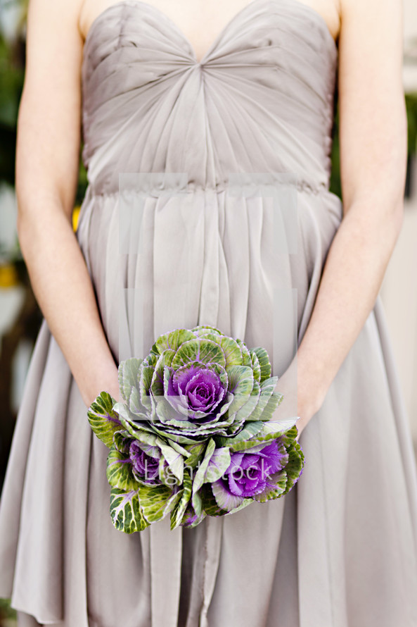 bridesmaid holding a bouquet