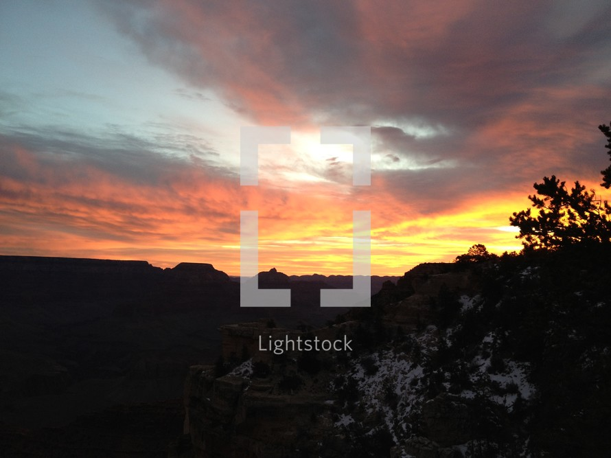sunset over cliffs of the Grand Canyon