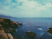 Ocean waves breaking on the rocky shoreline.