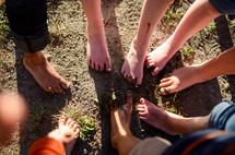 children's dirty feet in mud