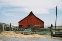 red barn and feeding area and fence