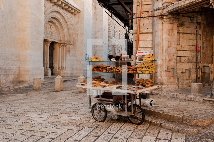 vender selling bread on the streets of Israel
