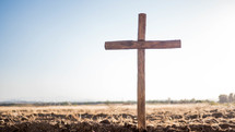 wooden cross in the ground