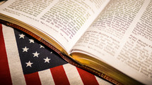 open Bible on an American flag