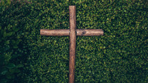 wooden cross in a bush