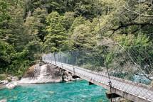 suspended bridge over a river
