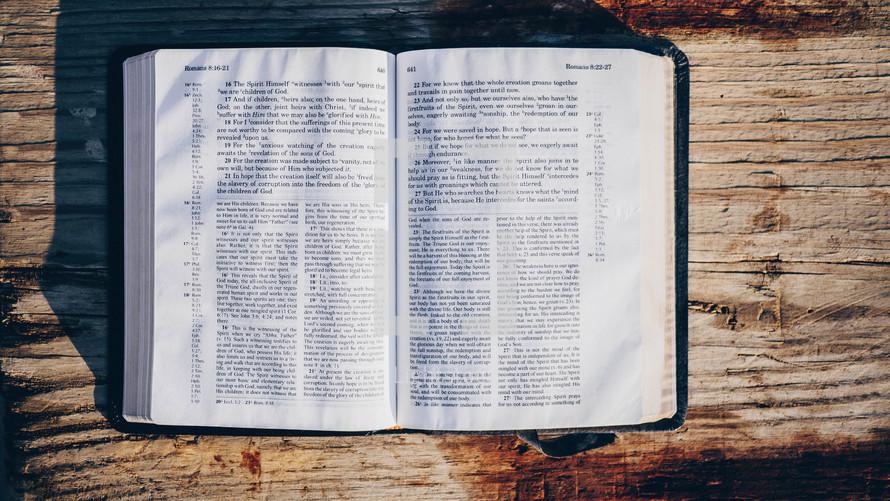 open Bible on a wood railing