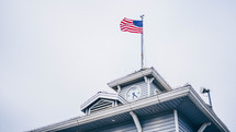 American flag on a flagpole of a roof