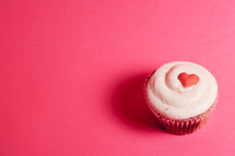 Valentines Day cupcake on pink background