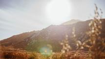 sunlight shinning on a mountain